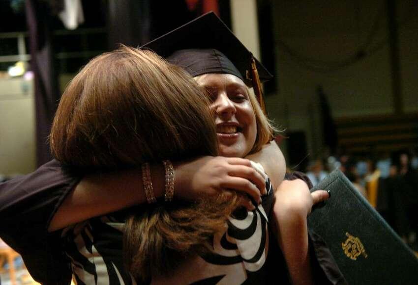 Student Lisa Marie Juliano hugs her teacher Darlene Richichi after getting her diploma at Platt Technical School's graduation ceremony in Milford, Conn. on Friday June 11, 2010.