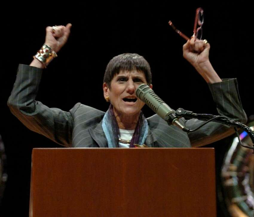 With arms raised U.S. Congresswoman Rosa DeLauro exclaims,
