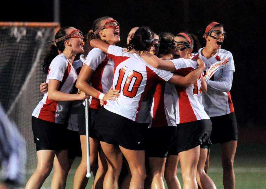 The Greenwich High School Cardinals celebrate an 11-9 victory over Darien High School, June 9, 2010 at Fairfield Warde High School, during the Girls Lacrosse Division I State Semifinals. Photo: Bob Luckey, ST / Greenwich Time