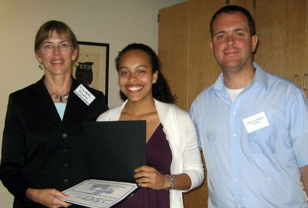 Brien McMahon High School Senior Cheyenne Paris, center, won a Younng Mediator of the Year Award from Connecticut's Dispute Settlement Center. On her left is Dispute Settlement Center Youth and Schools Director Elizabeth Murphy. On her right is the John Castelleuzzo, co-adviser of Brien McMahon's peer mediation program.