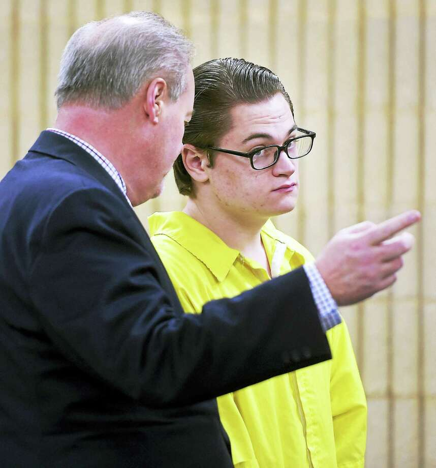 Attorney Edward Gavin, left, speaks with his client, Christopher Plaskon, at a hearing in Superior Court in Milford Feb. 23. Photo: Arnold Gold — New Haven Register