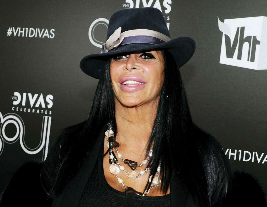 "In this Dec. 18, 2011, file photo, Angela Raiola, better known as Big Ang, arrives at ""Vh1 Divas Celebrates Soul"" in New York. Raiola from the reality TV series ""Mob Wives"" has died following a nearly yearlong battle with cancer, Series producer Jennifer Graziano said Thursday, Feb. 18, 2016. Photo: AP Photo/Charles Sykes, File    / FR170266 AP"