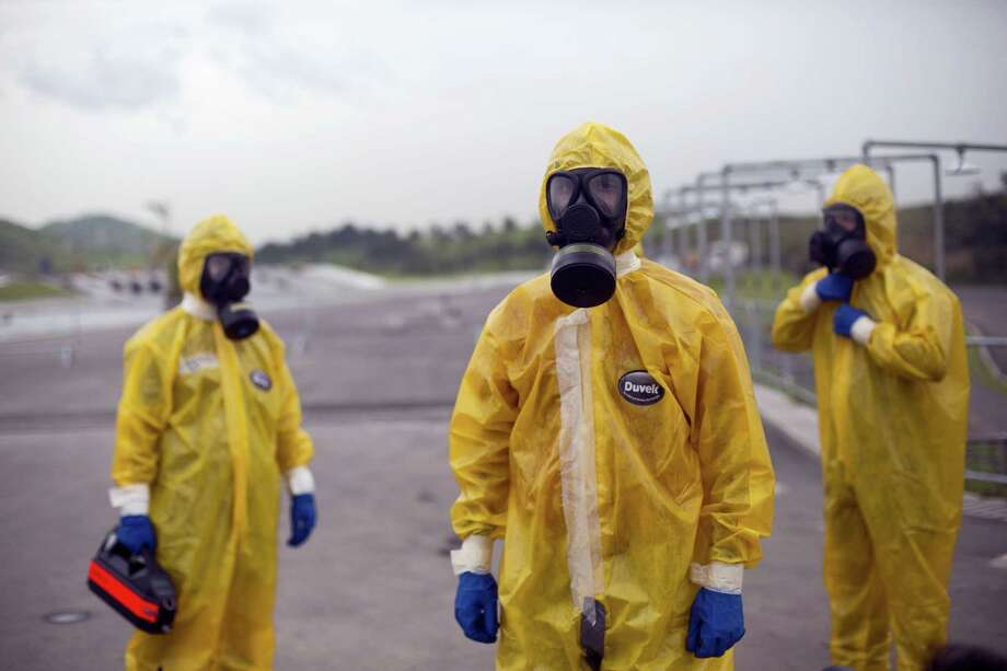 Army soldiers dressed in hazmat suits take part in a security drill at the Deodoro Olympic Park, in Rio de Janeiro, Brazil, Friday, March 11, 2016. Brazilian army personnel took part in the security drill as preparation for the upcoming 2016 Olympic Games. Photo: AP Photo/Silvia Izquierdo    / AP