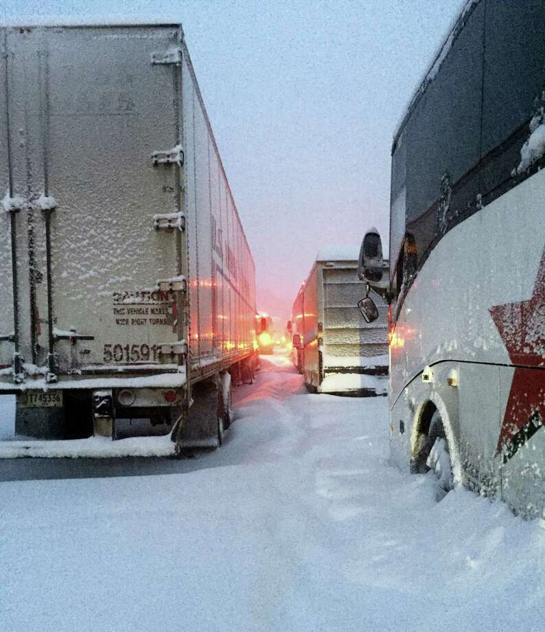 In this photo provided by Dave Saba, traffic is at a standstill on the Pennsylvania Turnpike near Somerset, Pa., Saturday, Jan. 23, 2016.  The Duquesne men's basketball team and Temple University's women's gymnastics team are stuck on the Turnpike due to a treacherous weather conditions.   A mammoth winter storm crawled up the U.S. East Coast Saturday, making roads impassable, shutting down mass transit, and bringing Washington and New York City to a standstill. Photo: Dave Saba Via AP / Dave Saba