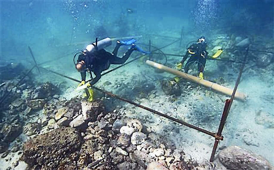 In this undated photo made available by Blue Water Recoveries company on Tuesday, March 15, 2016, divers excavate the wreck site of the Portuguese explorer Vasco da Gama's ship, Esmeralda which sank in a storm in May 1503 off the coast of Al Hallaniyah island in Oman's Dhofar region. Photo: Blue Water Recoveries Company Via AP    / Blue Water Recoveries company