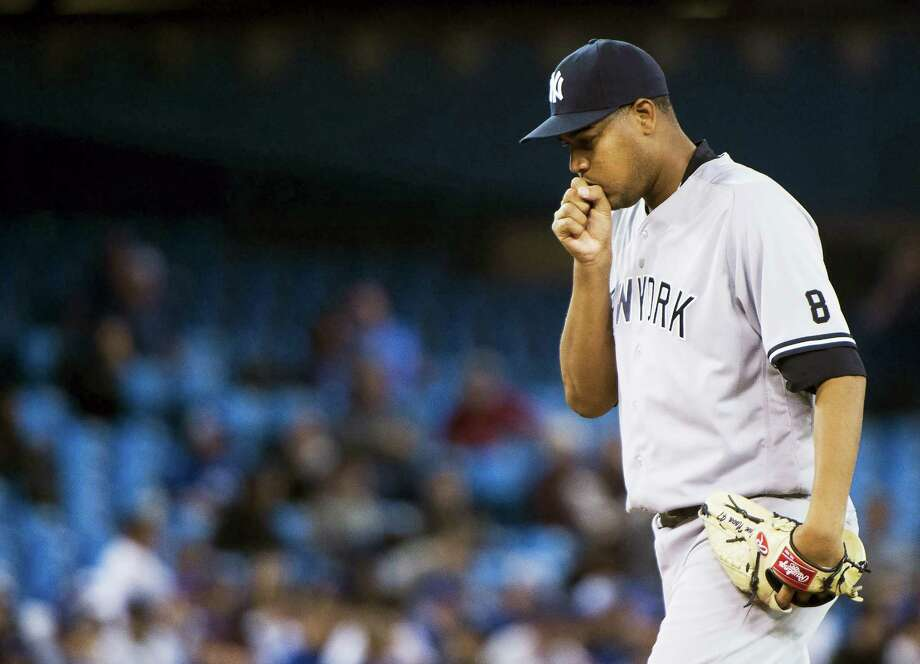 Yankees pitcher Ivan Nova (47) reacts after allowing runs against the Blue Jays in the eighth inning on Wednesday. Photo: Nathan Denette — The Canadian Press Via AP   / The Canadian Press
