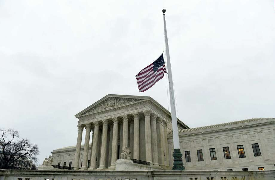 The flag flies at half-staff outside the Supreme Court in Washington, Tuesday, Feb. 16, 2016, following the death of Supreme Court Justice Antonin Scalia over the weekend. Photo: AP Photo/Susan Walsh    / AP