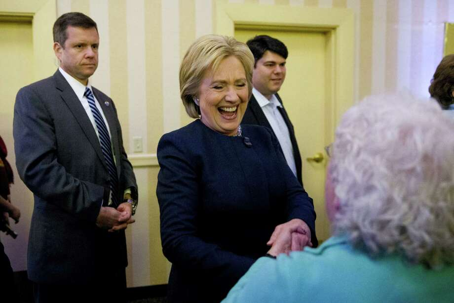 Democratic presidential candidate Hillary Clinton meets an attendee Friday, Jan. 22, 2016, at a NARAL Pro-Choice dinner in Concord, N.H. Photo: AP Photo/Matt Rourke / AP