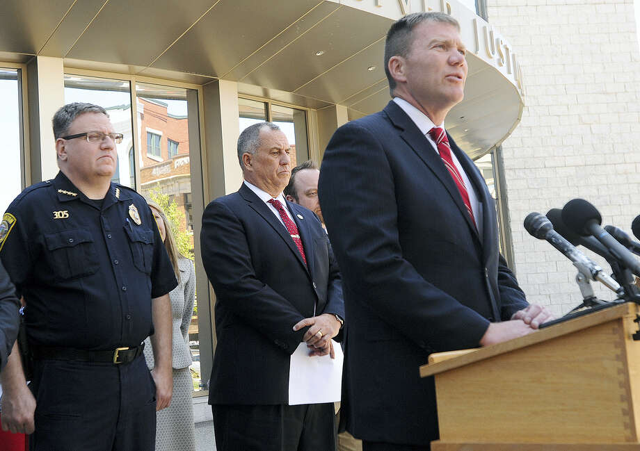 Taunton, Mass., Mayor Thomas Hoye, Jr., right, speaks about Tuesday's stabbings at a Taunton home and shopping mall Wednesday in Fall River, Mass. Behind him are Taunton Police Chief Edward Walsh, left, and Bristol County District Attorney Thomas Quinn III. Photo: Jack Foley — The Herald News Of Fall River Via AP   / Jack Foley