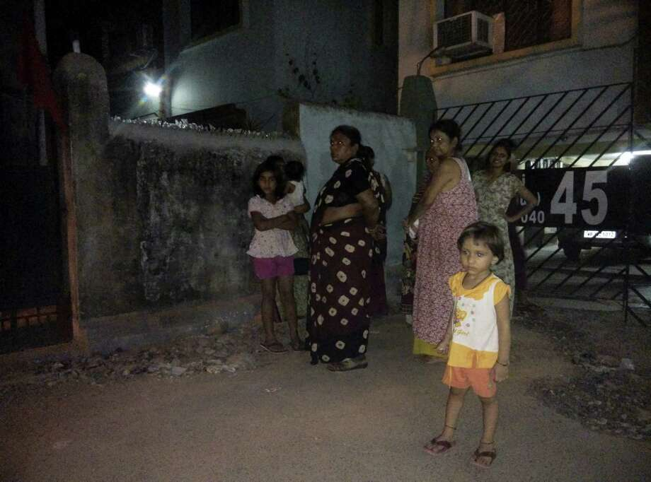 Residents who rushed outdoors following tremors stand on a road outside their houses in Kolkata, India, Wednesday, April 13, 2016. A strong earthquake struck Myanmar on Wednesday night and was felt in parts of eastern India and Bangladesh. There were no immediate reports of injuries or damage. Photo: AP Photo/Bikas Das    / AP