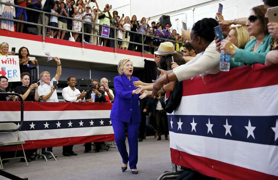 Democratic presidential candidate Hillary Clinton reacts as she enters a rally, Monday, June 6, 2016, in Long Beach, Calif. Photo: AP Photo/John Locher    / Copyright 2016 The Associated Press. All rights reserved. This material may not be published, broadcast, rewritten or redistribu