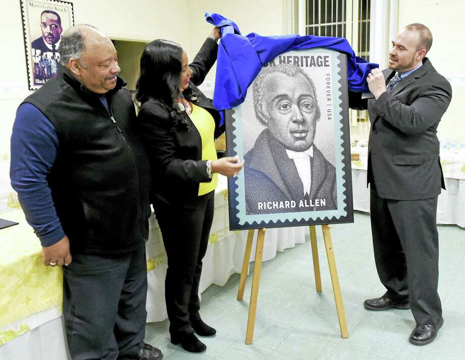 Greater New Haven Branch NAACP First Vice President Anthony Dawson, left, and President Dori Dumas, center, assist New Haven Postmaster Tom Sullivan unveil the USPS 39th commemorative edition Black Heritage stamp of Bishop Richard Allen during a ceremony at St. Luke's Episcopal Church in New Haven Thursday. Photo: Peter Hvizdak — New Haven Register   / ©2016 Peter Hvizdak