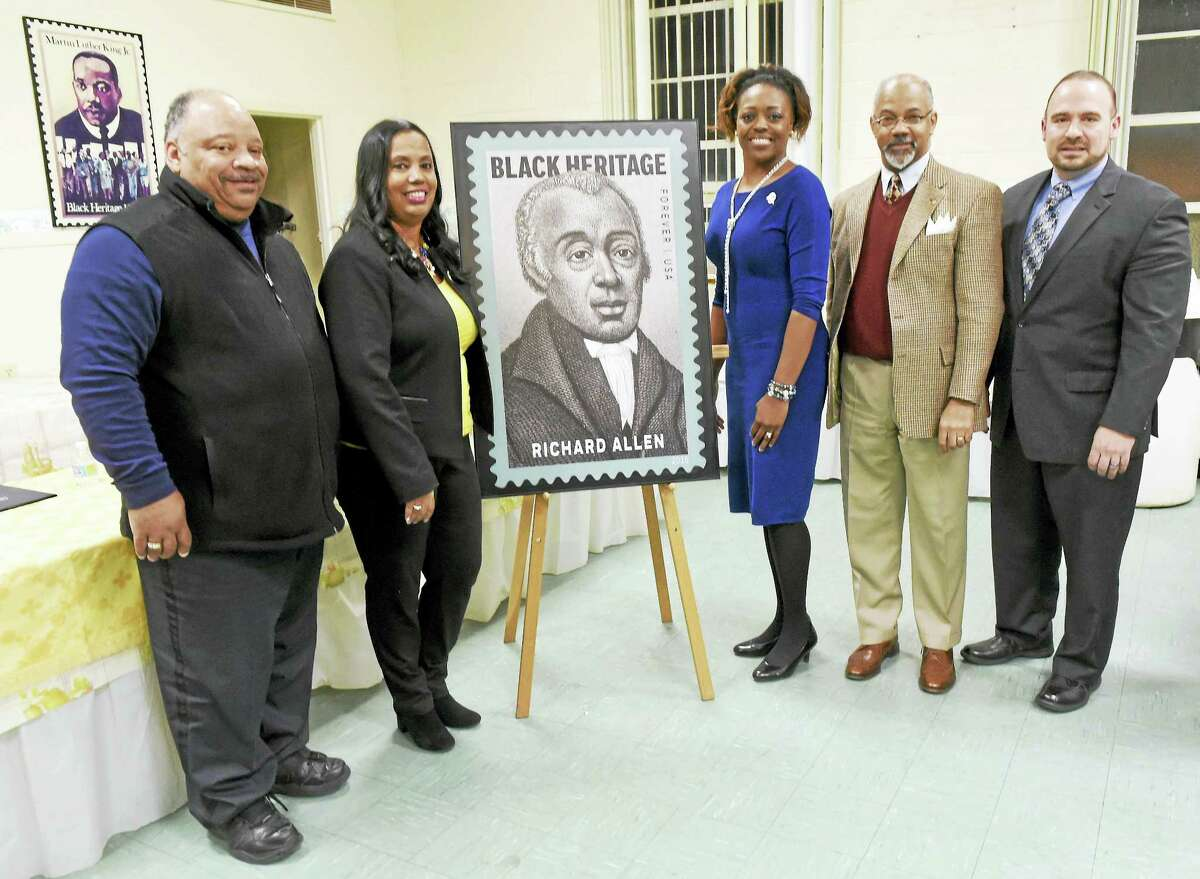 From left, Greater New Haven Branch NAACP First Vice President Anthony Dawson and President Dori Dumas; the Rev. Orsella Cooper-Hughes of Bethel AME Church in New Haven; Robert Gibson of New Haven, a retired history teacher; and New Haven Postmaster Tom Sullivan after the unveiling of the Black Heritage stamp of Bishop Richard Allen in New Haven Thursday.