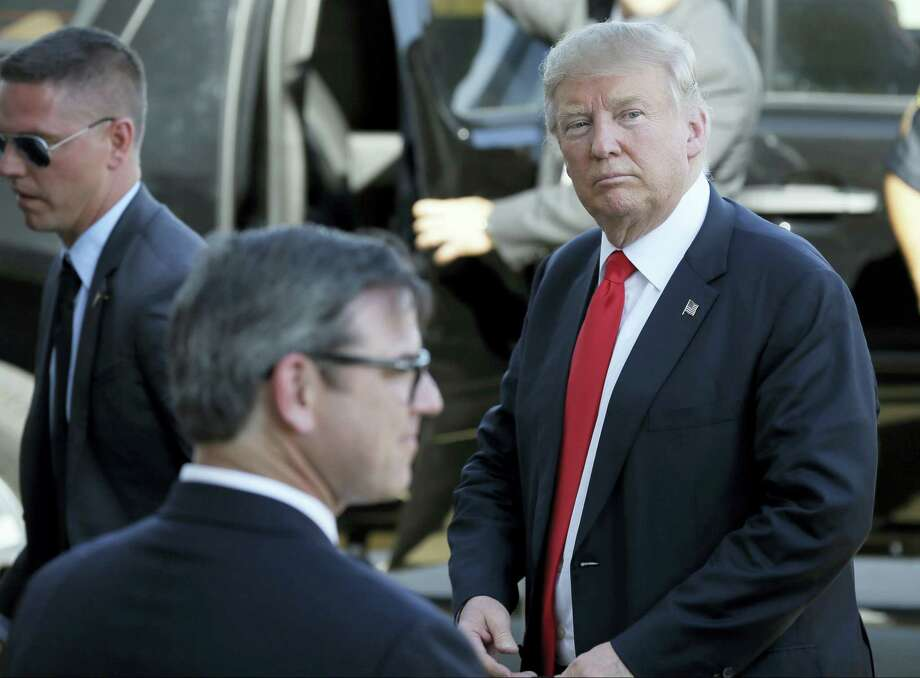 In this May 6, 2016 photo, Republican presidential candidate Donald Trump looks at supporters after speaking at a rally in Omaha, Neb. Photo: AP Photo — Charlie Neibergall, File   / AP