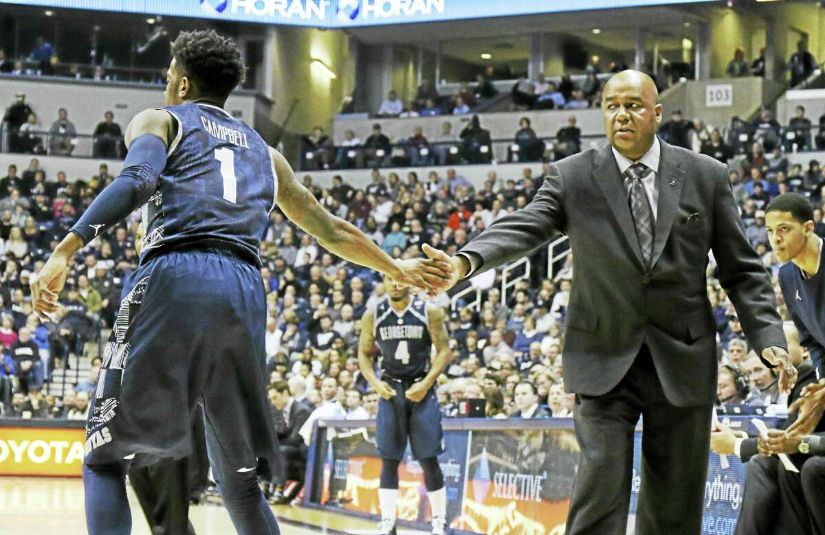Coach John Thompson III, right, and Georgetown will be in Hartford today to face UConn.