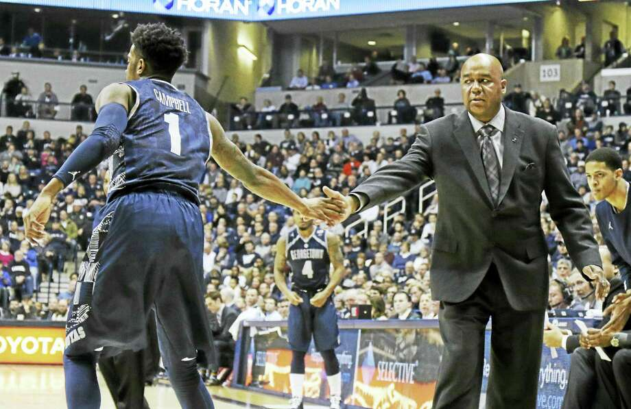 Coach John Thompson III, right, and Georgetown will be in Hartford today to face UConn. Photo: The Associated Press File Photo   / FR171284 AP