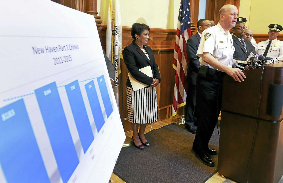 New Haven Police Chief Dean Esserman, right, speaks during a press conference Wednesday at City Hall where Esserman and Mayor Toni Harp, left, announce a 5-year overall drop in New Haven crime statistics.