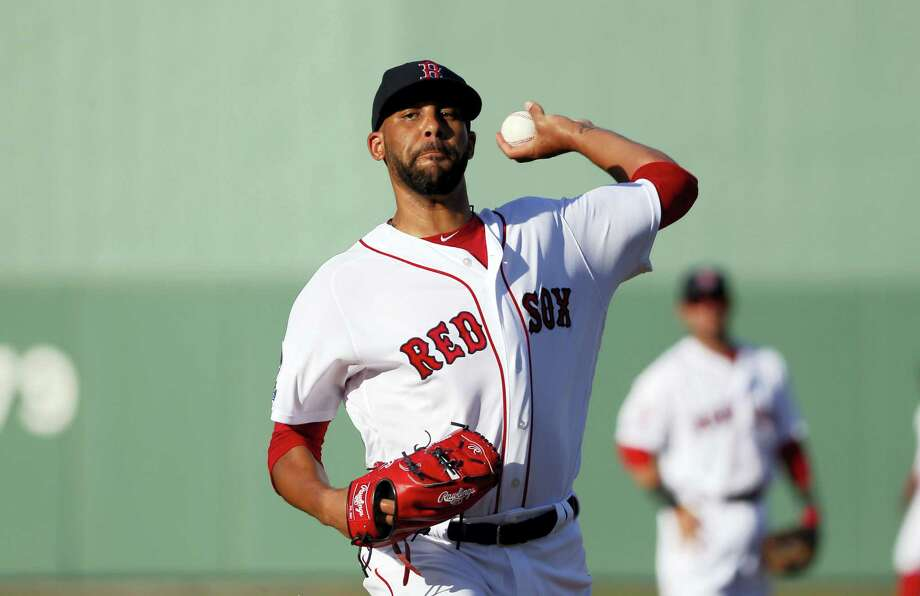 Red Sox starting pitcher David Price (24) throws warm up pitches before Tuesday's spring training game against the Yankees. Photo: Tony Gutierrez — The Associated Press   / AP