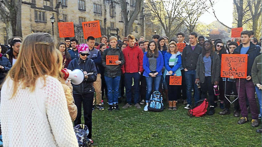 Fossil Free Yale rallied on Cross Campus Tuesday after a speech by U.N. Secretary-General Ban Ki-moon. Photo: ED STANNARD — NEW HAVEN REGISTER