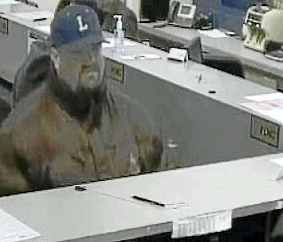 Milford police are asking the public to help them find this man who allegedly robbed People's United Bank, 190 Broad St., early Wednesday afternoon. Photo: Photo Courtesy Of The Milford Police Department
