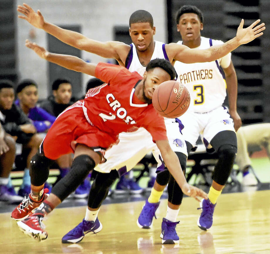 Malik Alston of Wilbur Cross High School, left, is fouled by Dashawn Williams of Career, center, as Career teammate Tamar Williams watches, far right, during the first quarter of the game Tuesday night. Photo: Peter Hvizdak — New Haven Register   / ?2016 Peter Hvizdak
