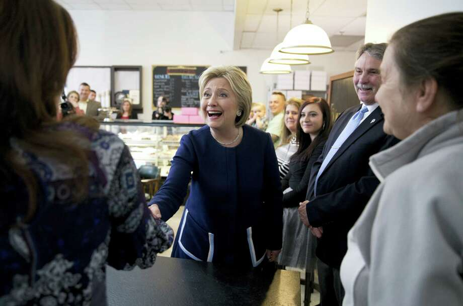 ASSOCIATED PRESS  Democratic presidential candidate Hillary Clinton greeted people as she arrived for a campaign visit at 8 Sisters Bakery in Marion, Ohio, on Sunday. Photo: AP / AP