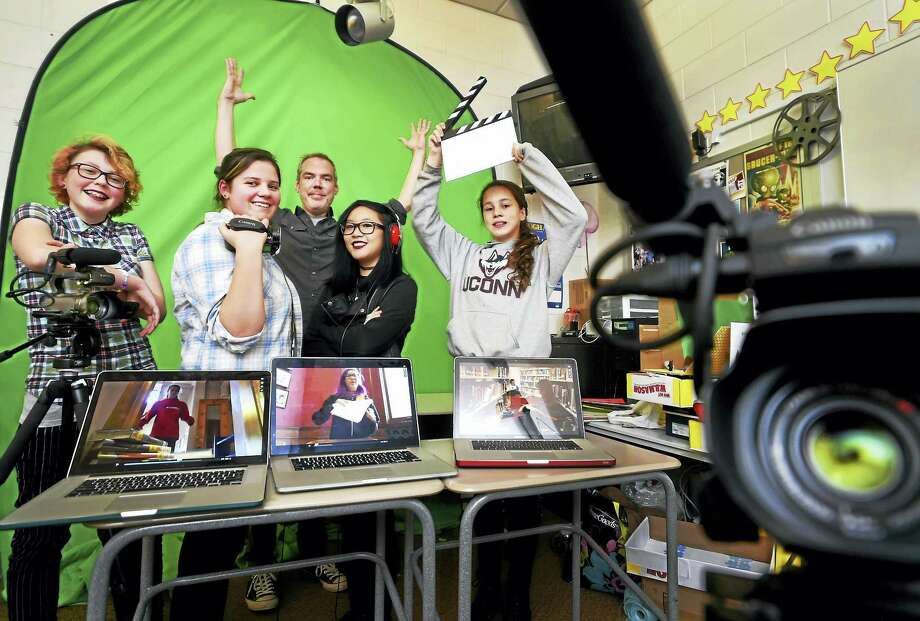 New Haven Betsy Ross Arts Magnet School students at Blackstone Library in Branford with their video production teacher Matt Kelsey, center. From left: Emma Bender, 13, of New Haven; Rebeca DeMatteo, 14, of East Haven; Natalie Leonffu, 14, of Branford; and Olivia Campbell, 13, of Branford. Photo: Peter Hvizdak — New Haven Register   / ©2016 Peter Hvizdak