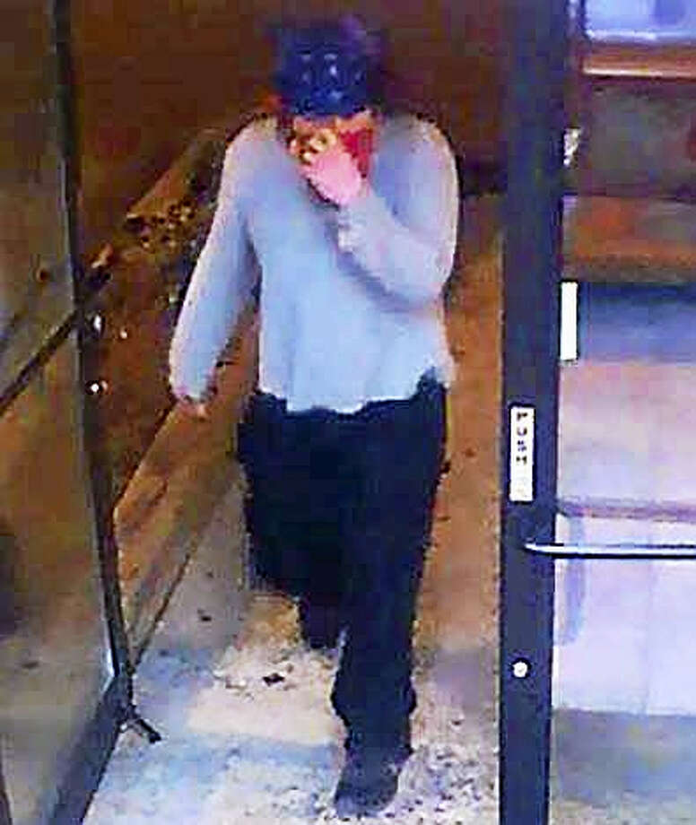 Orange police are looking for this man who allegedly robbed a Subway restaurant Saturday night. Police say he is likely the same man who held up Dip Top Friday night. Photo: Courtesy Of Orange Police Department