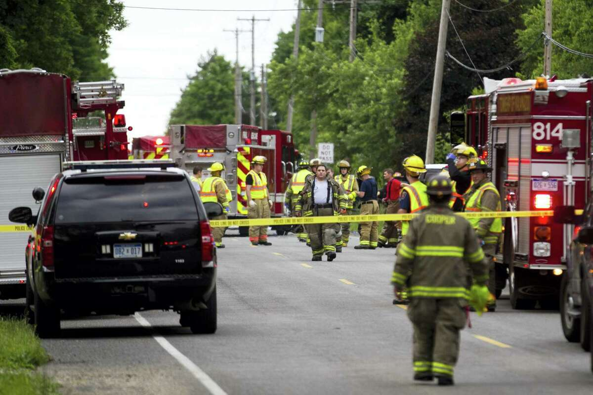 Police and rescue workers attend to the scene after multiple bicyclists were struck by a vehicle in a deadly crash Tuesday, June 7, 2016, in Copper Township, Mich.