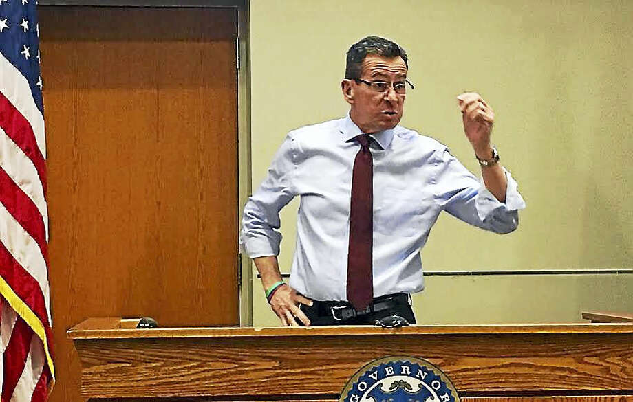 Gov. Dannel P. Malloy speaks at a town forum in Middletown's Council Chambers Tuesday to address his proposed budget reductions and how the state is adapting to the changing economy. Photo: Sam Norton — The Middletown Press