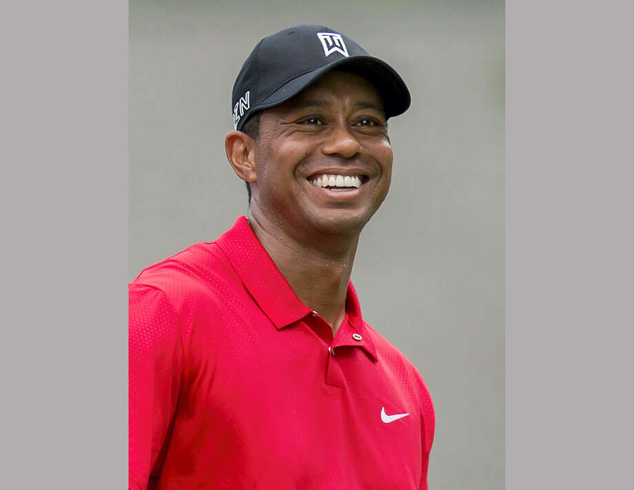 Tiger Woods is writing his first book since 2001 that is due out next spring. The book does not have a title, but it will be about his historic victory in the 1997 Masters. Woods is writing the book with Canadian golf writer Lorne Rubenstein. Photo: The Associated Press File Photo   / FR171364 AP