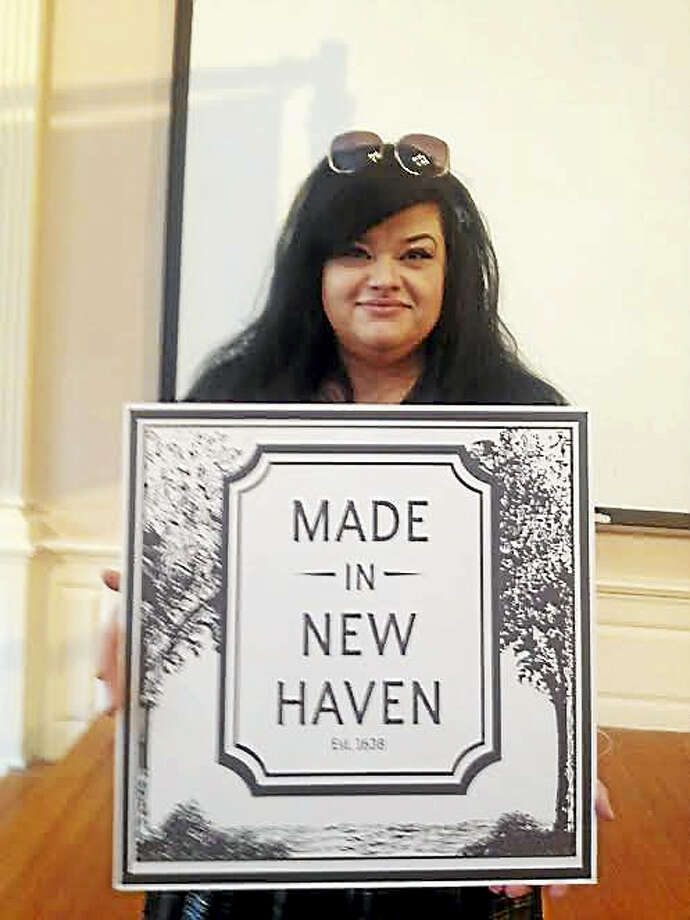 Kelly Bigelow Becerra holds the logo she designed for Made in New Haven products. Photo: Mary O'Leary — New Haven Register