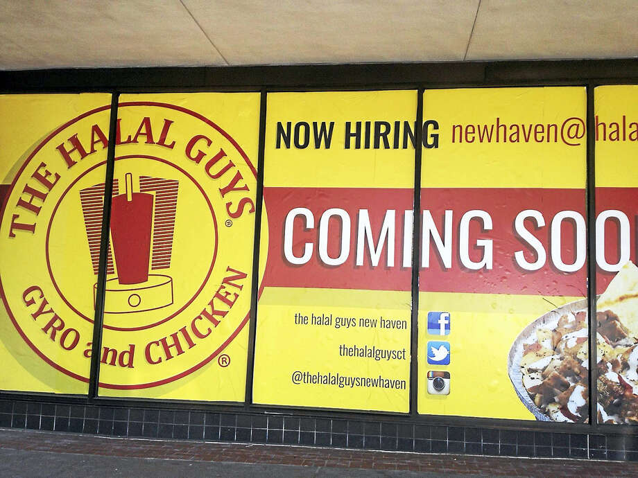 Mary O'Leary - New Haven Register Window at 906 Chapel St., New Haven,  is covered with a sign for The Halal Guys, which is coming in September. Photo: Journal Register Co.