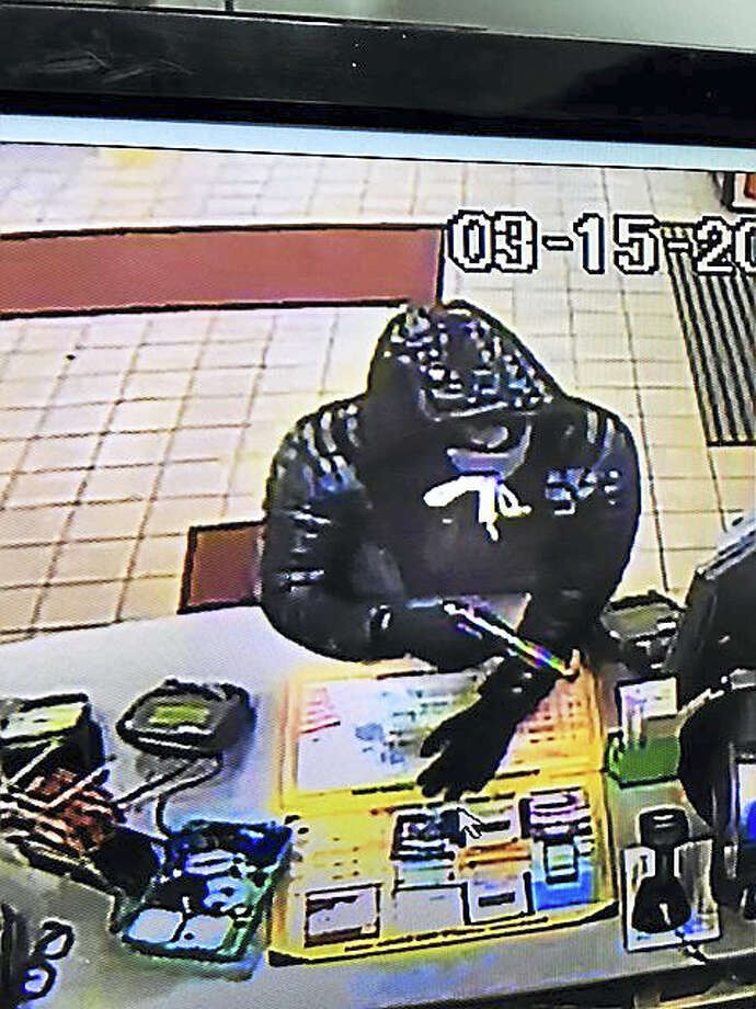 East Haven police are looking for this man in connection with an armed robbery Tuesday. Photo: Photo Courtesy Of The East Haven Police Department