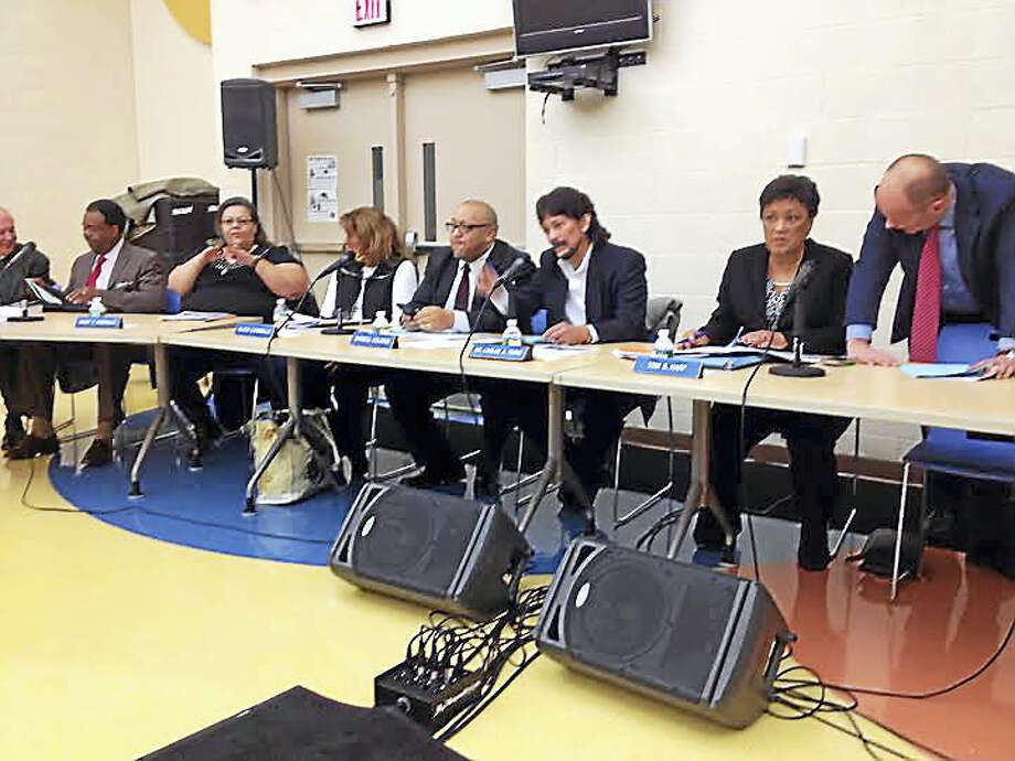 The Board of Education meets in January. From left, Michael Nast, Edward Joyner, Daisy Gonzalez, Alicia Caraballo, Darnell Goldson, Carlos Torre, Mayor Toni Harp and Superintendent of Schools Garth Harries. Board member Che Dawson arrived later. Photo: (Brian Zahn - New Haven Register)