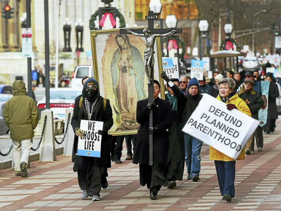 Norma Contois of Branford, right, leads Friday's anti-abortion march up Church Street by New Haven City Hall. Photo: PETER HVIZDAK — NEW HAVEN REGISTER   / ©2016 Peter Hvizdak