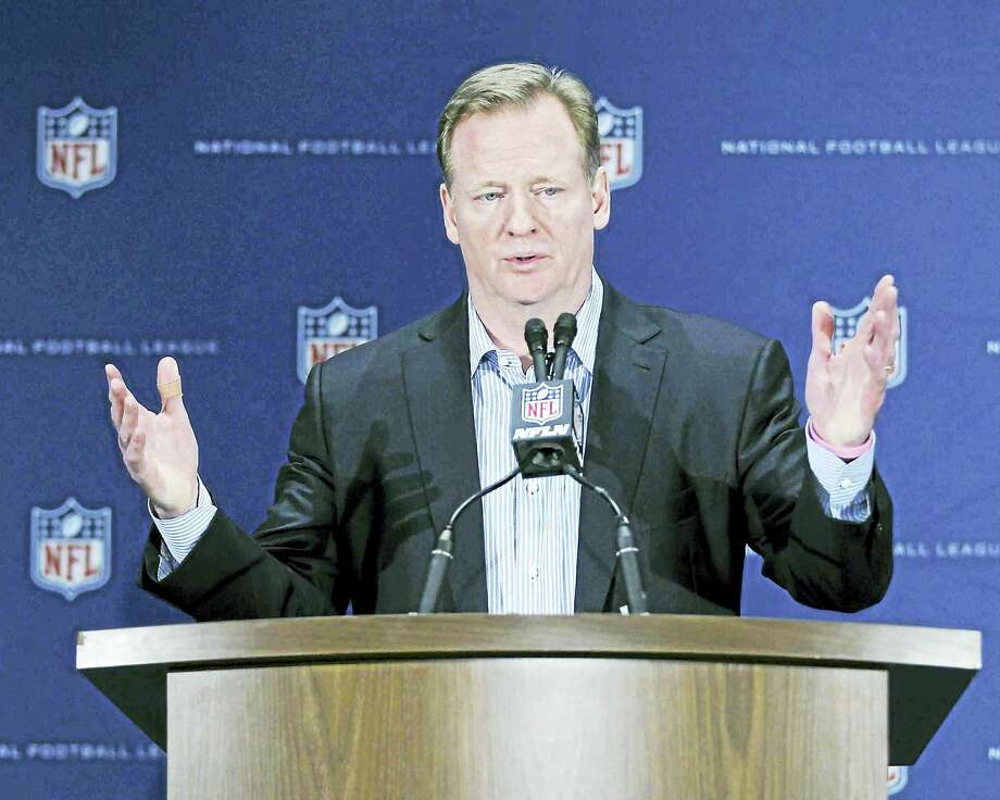 National Football League Commissioner Roger Goodell gestures during a press conference.  A new study says more than 40 percent of retired NFL players had been found to have signs of traumatic brain injury. Photo: Associated Press File Photo