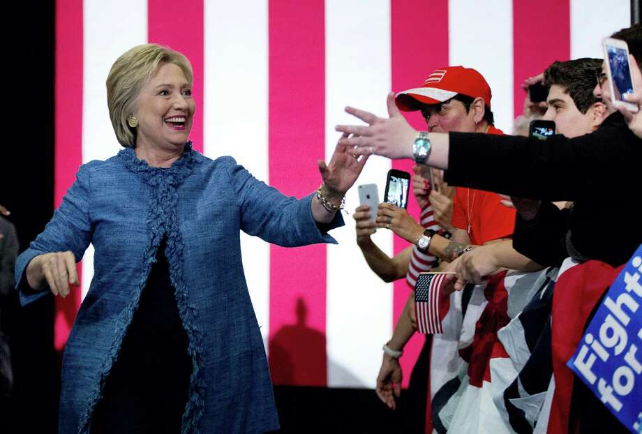 Democratic presidential candidate Hillary Clinton arrives to a cheering crowd at an election night event Tuesday at the Palm Beach County Convention Center in West Palm Beach, Fla. Photo: Associated Press   / AP