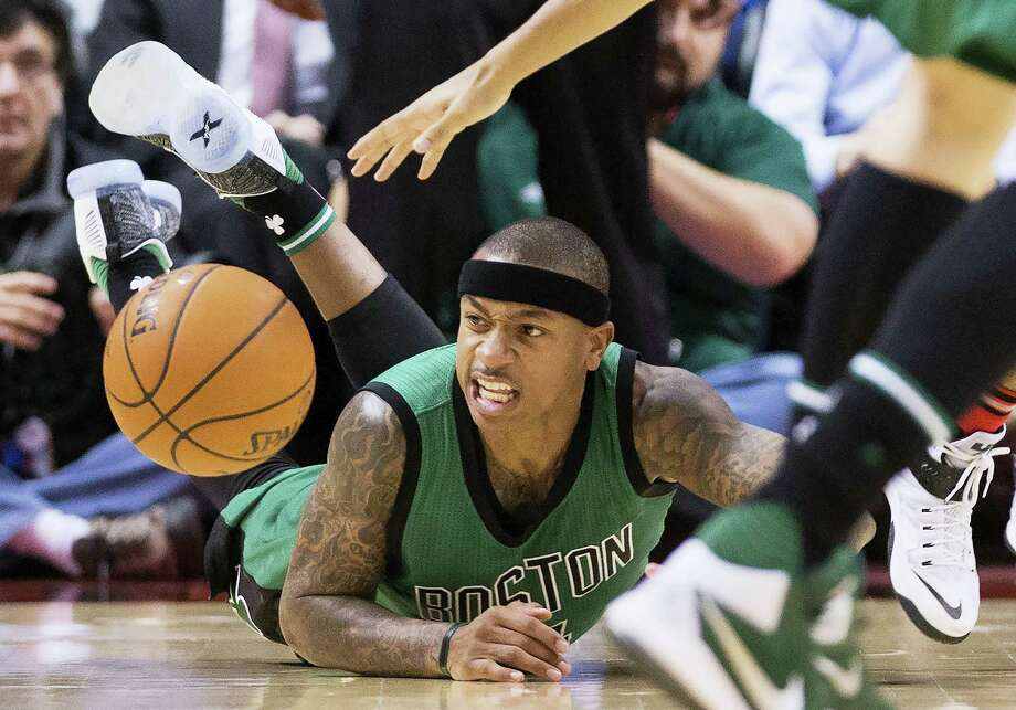 Boston Celtics guard Isaiah Thomas eyes a loose ball during the second half of an NBA basketball game against the Toronto Raptors in Toronto on Wednesday, Jan. 20, 2016. (Nathan Denette/The Canadian Press via AP) Photo: AP / The Canadian Press