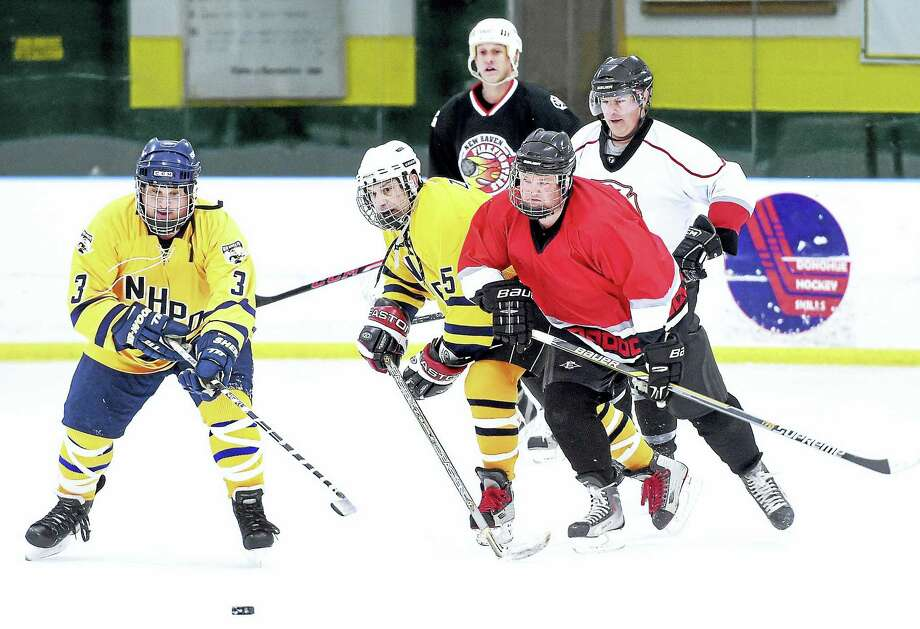 Members of the New Haven police and fire departments scrimmage at the Louis Astorino Ice Arena in Hamden Tuesday in preparation for the upcoming Chief's Cup. Photo: Arnold Gold — New Haven Register