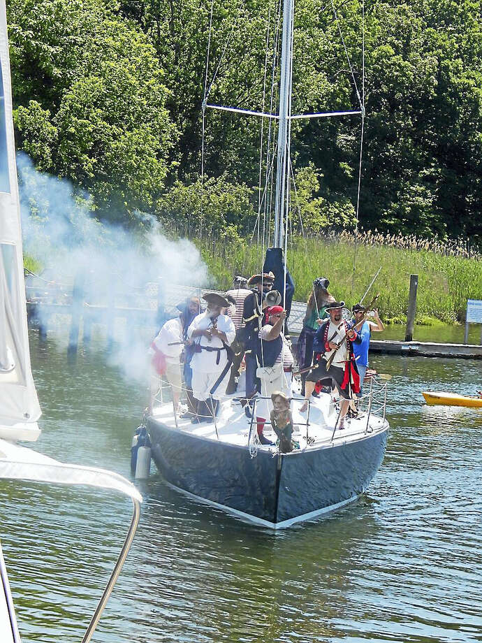 The popular Pirates Day in Milford begins with the arrival of a boat load of pirates in Milford Harbor, Mayor Ben Blake among them. Contributed Photo Photo: Journal Register Co.