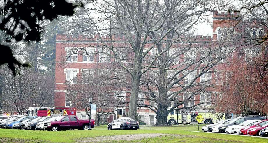 Emergency personnel respond Tuesday to Lauralton Hall in Milford. Ten studentds were taken to area hospitals and dozens more were treated at the school after someone released pepper spray in a school building. Photo: (Arnold Gold-New Haven Register)