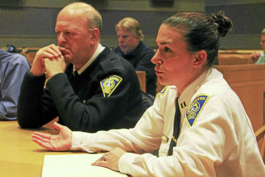 New Haven police Capt. Julie Johnson addresses the aldermanic Public Safety Committee while sitting next to police Chief Dean Esserman Tuesday during a meeting discussing a grant to pay for the relocation of the department's academy and firing range. Photo: Esteban L. Hernandez — New Haven Register
