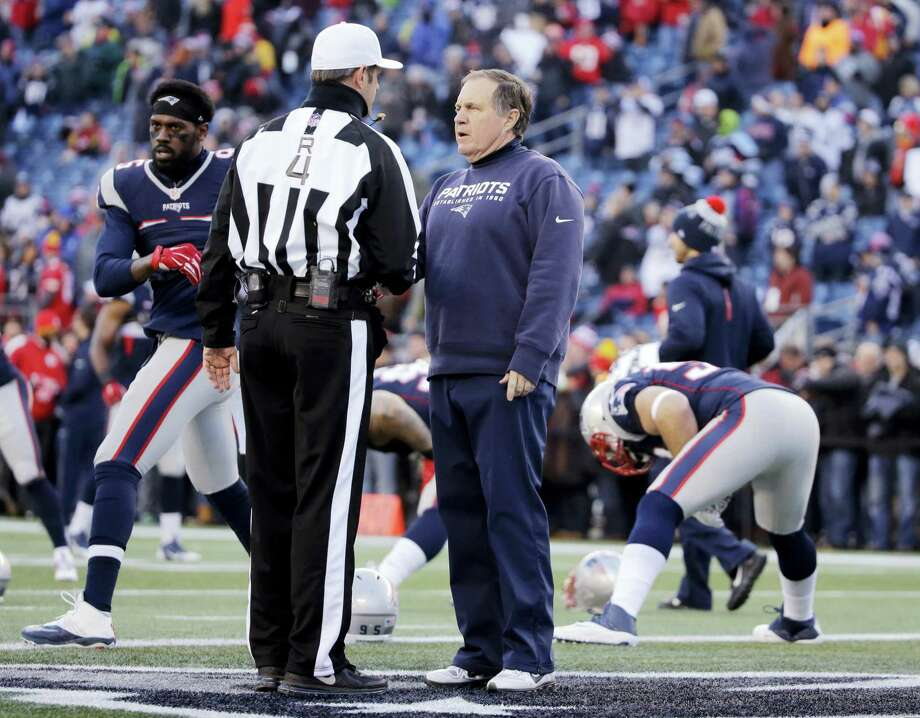 Referee Craig Wrolstad (4) speaks to Patriots head coach Bill Belichick before Saturday's game against the Chiefs. Photo: The Associated Press File Photo   / AP