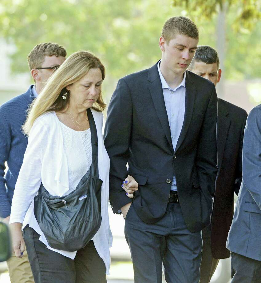 In this June 2, 2016 photo, Brock Turner, 20, right, makes his way into the Santa Clara Superior Courthouse in Palo Alto, Calif. The six-month jail term given to Turner, the former Stanford University swimmer who sexually assaulted an unconscious woman after both attended a fraternity party, is being decried as a token punishment. Photo: Dan Honda/Bay Area News Group Via AP   / Bay Area News Group