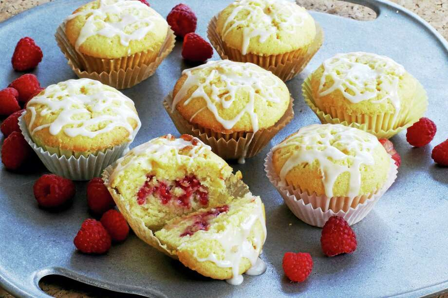 These rich muffins are well suited to dessert, but also would be fine for an indulgent breakfast. Made with juice and zest, their deep lemon flavor is complemented by the raspberries. Photo: J.M. Hirsch — The Associated Press   / AP