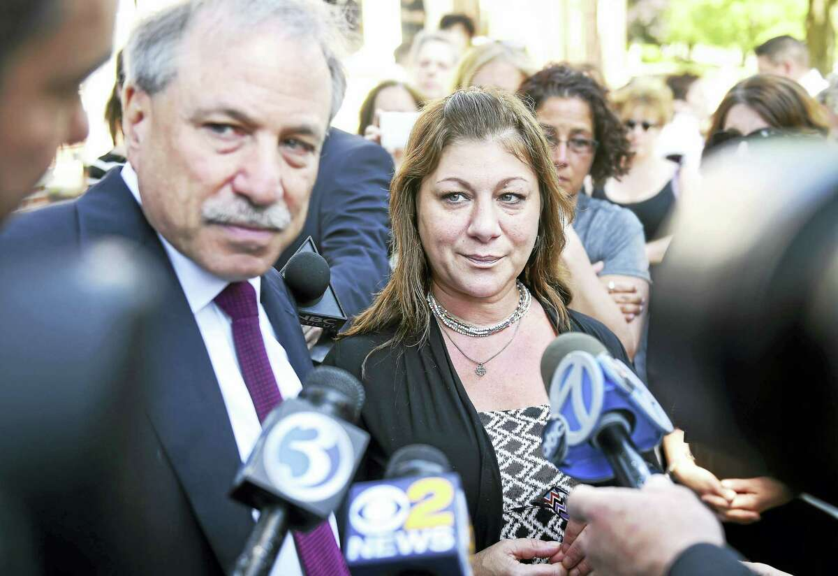 Donna Cimarelli-Sanchez, center, mother of Maren Sanchez, speaks with the press, accompanied by her attorney, David Golub, left, outside Superior Court in Milford after the sentencing of Christopher Plaskon Monday.