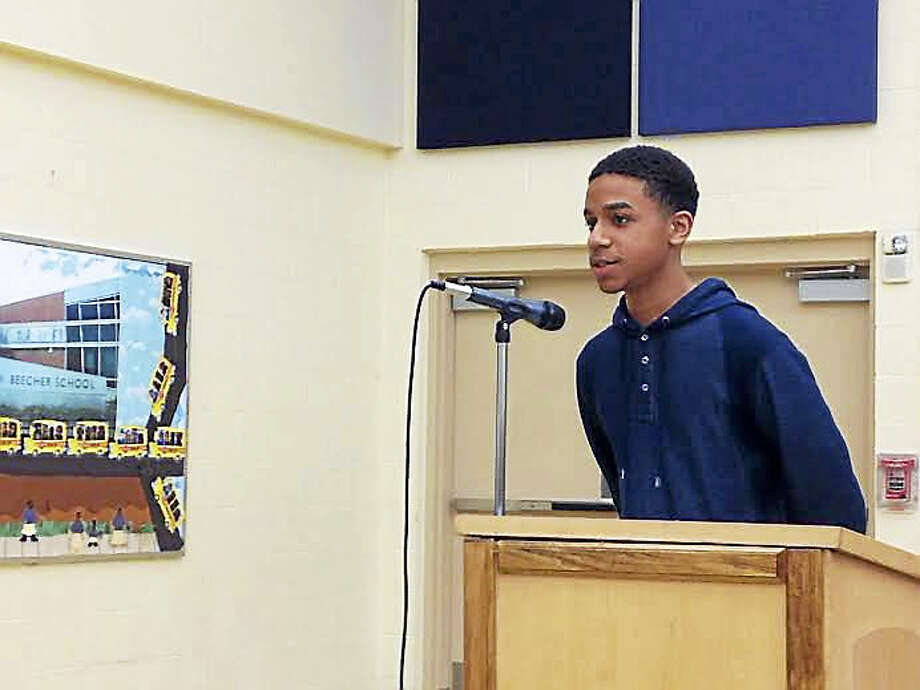 Jacob Spell, nonvoting student member elect of the New Haven Board of Education, briefly addresses the board at an April 11 meeting at L.W. Beecher Museum School of Arts & Sciences. Photo: Brian Zahn — New Haven Register