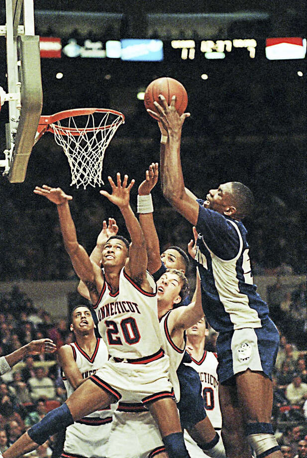 UConn's Murray Williams (20) tries in vain to thwart the shot of Georgetown's Dikembe Mutombo during te Big East tournament in New York on March 10, 1990. The Huskies won that game 65-60. Photo: The Associated Press File Photo   / AP1990
