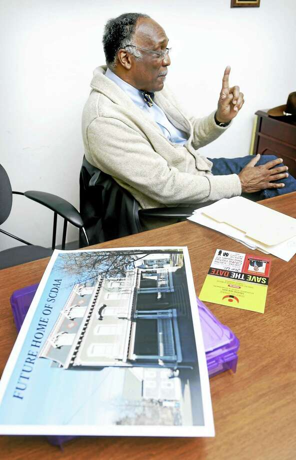 James Rawlings, board chairman of the Sickle Cell Disease Association of America of Southern Connecticut,  talks about sickle cell disease and local initiatives including the future home of the SCDAA of Southern Connecticut (foreground photo) in New Haven. Photo: Arnold Gold — New Haven Register